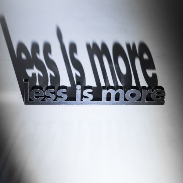 Less Is More.Less Is More Paperweight